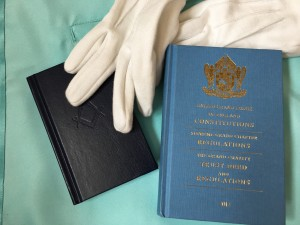 Masonic book of Constitutions and gloves